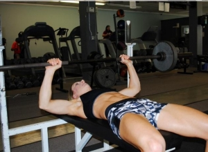 Randi Lackey working on bench press.